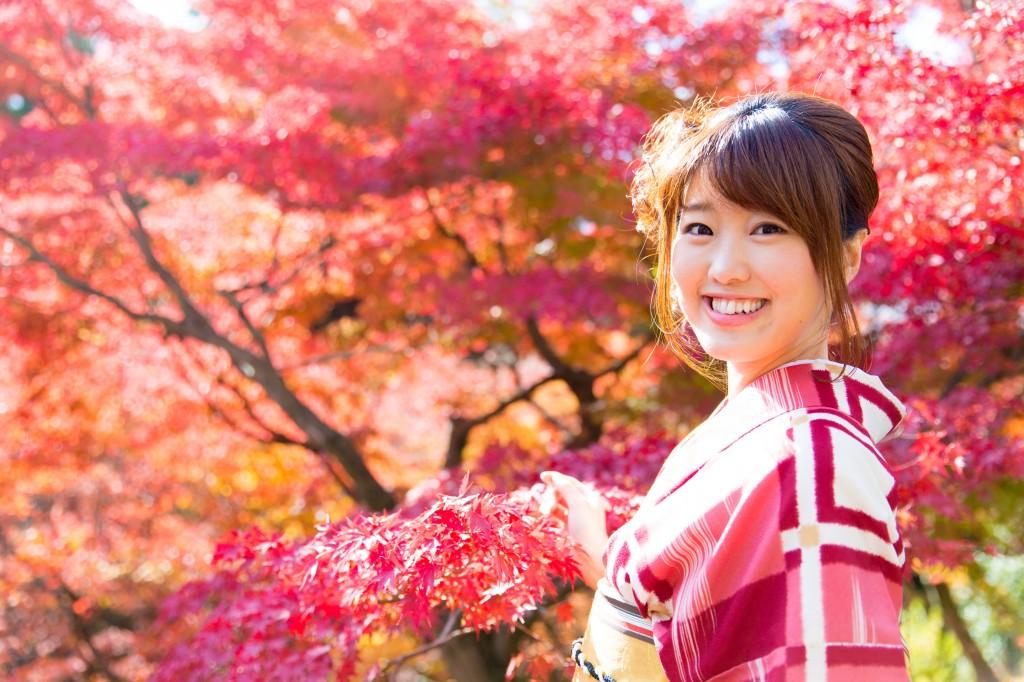 asian woman wearing japanese kimono in fall