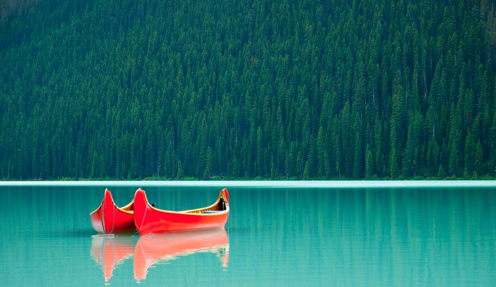 Canoes floating peacufully on Lake Louise near Banff.